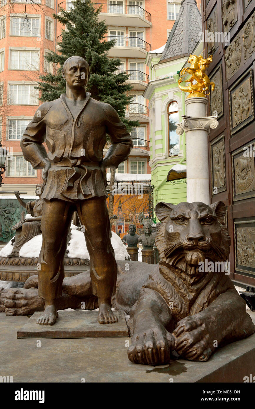 Moscow, Russia - March 22, 2018. Statue of Vladimir Putin in judo costume, with tiger at his feet, in the courtyard of Tsereteli museum in Moscow. - Stock Image