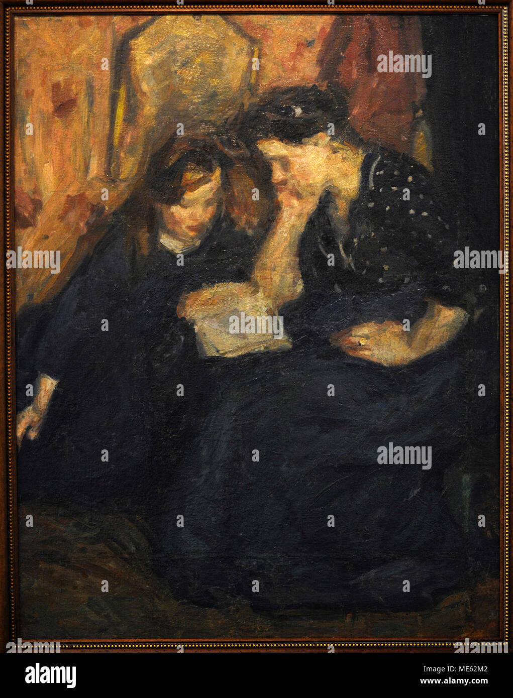 Vladas Eidukevicius (1891-1941). Lithuanian painter. Mother teaching her daughter to read, ca.1918. National Gallery of Art. Vilnius. Lithuania. - Stock Image