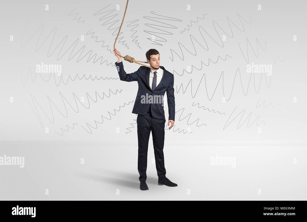 Hopeless young businessman trying to suicide with question signs concept  - Stock Image
