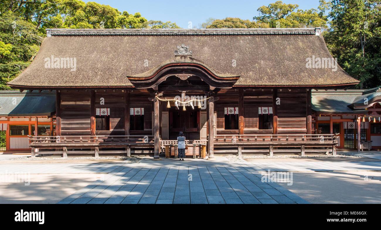Worshiper at main shrine, Ōyamazumi Jinja, , Omishima island,  Seto Inland Sea, Japan - Stock Image