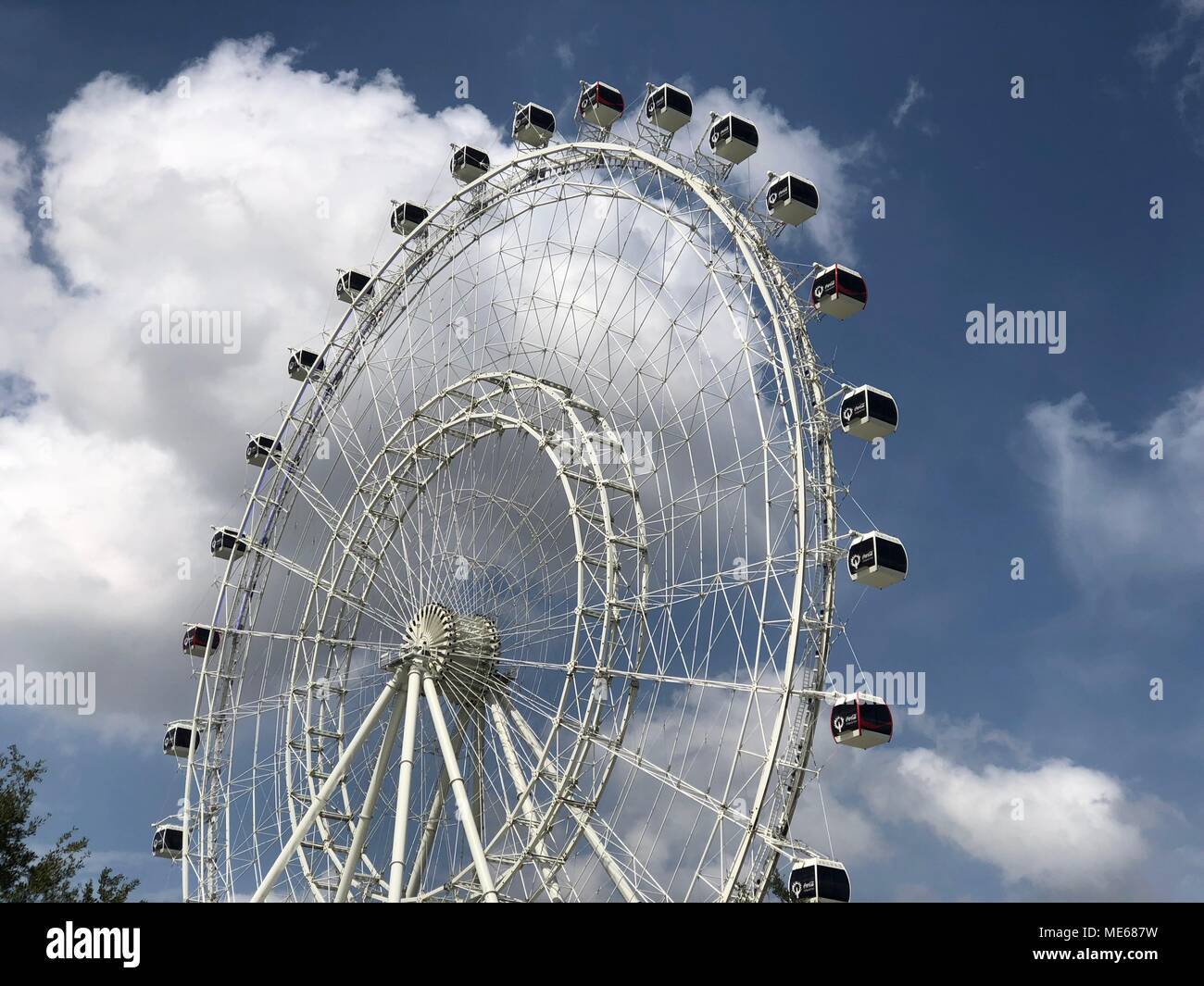 The Orlando Eye, a 400 ft tall giant Ferris wheel and the largest observation wheel on the East Coast of the United States. Located  Orlando, Florida. Stock Photo