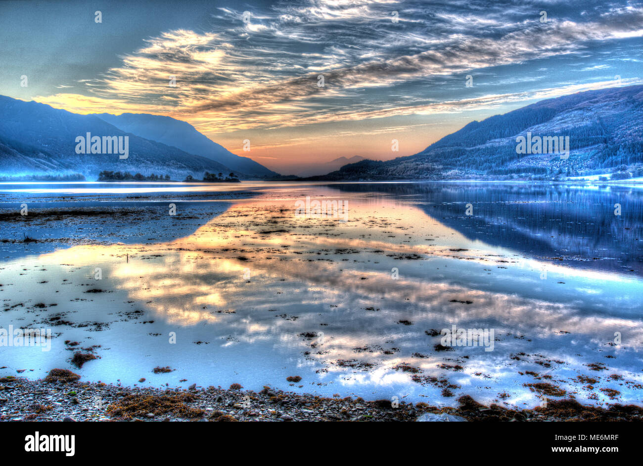 Area of Gen Coe, Scotland. Artistic dusk view of Loch Leven with North Ballachulish in the distant background. - Stock Image