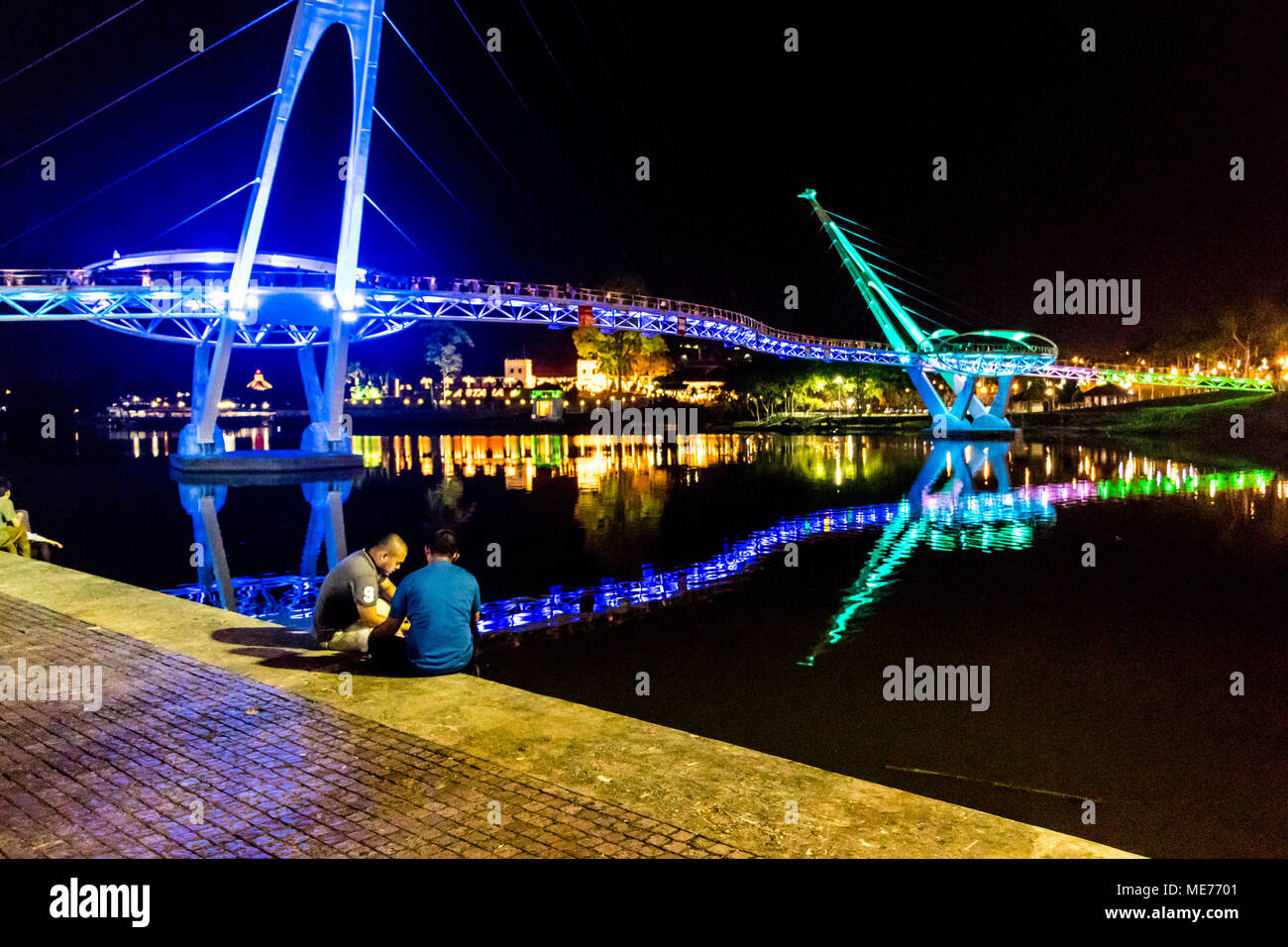 Darul Hana bridge or Golden Bridge over the Sarawak river at nighttime in the city of Kuching Sarawak Malaysia Island of Borneo - Stock Image