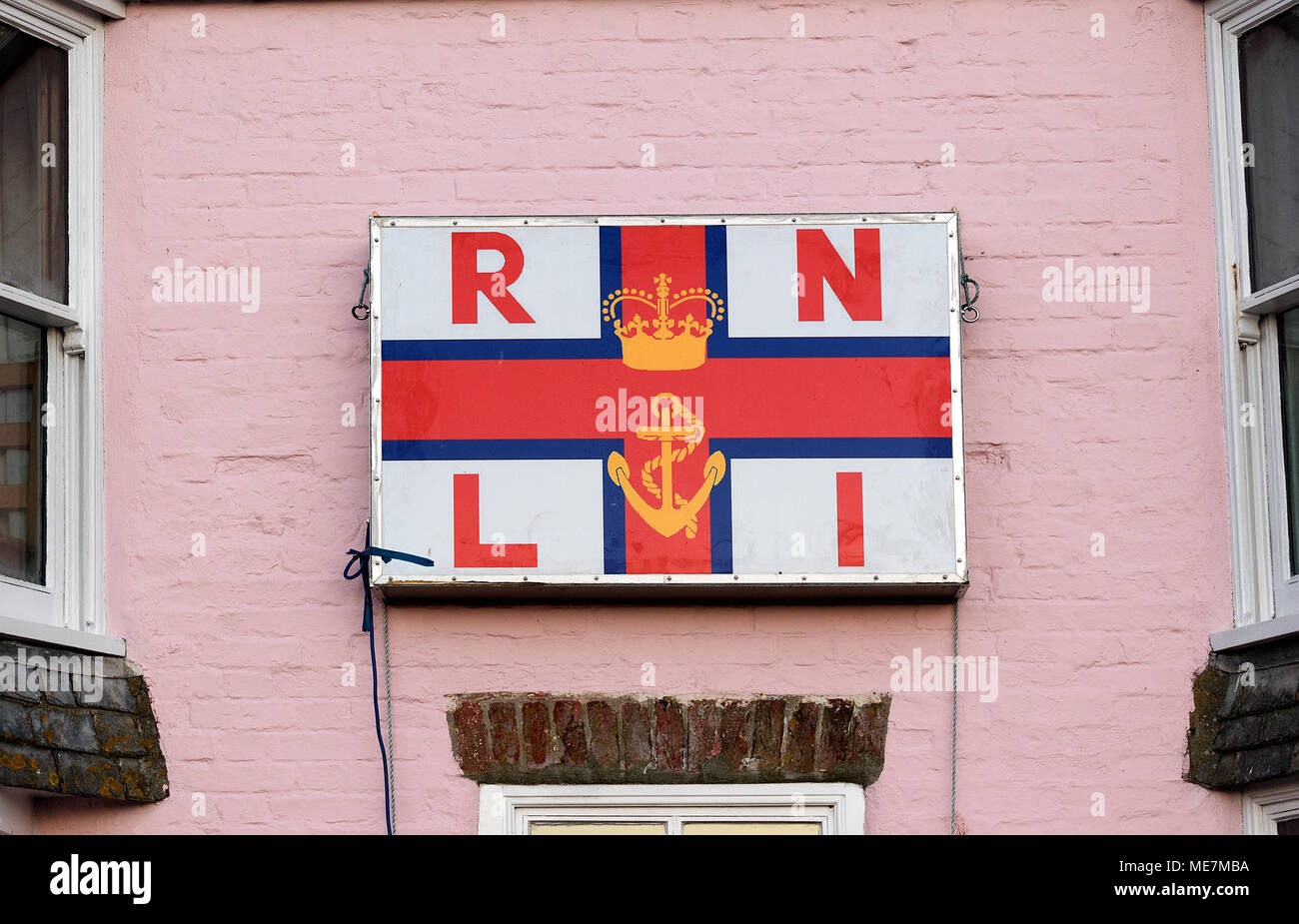 royal national lifeboat institution, rnli, sign, poster, logo on a cottage in mousehole, cornwall, uk. - Stock Image