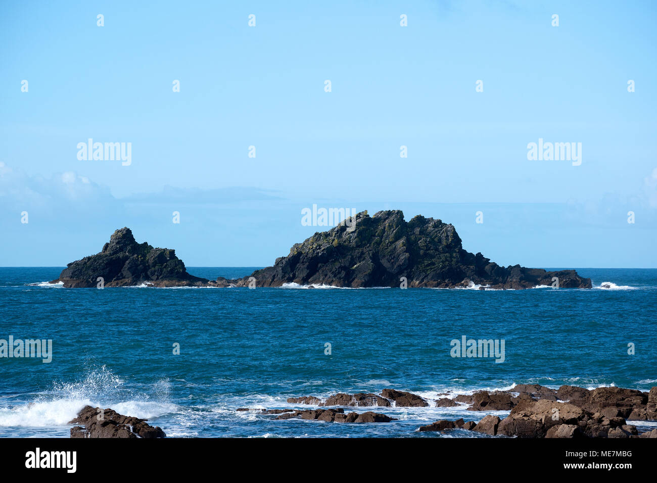 the brisons a twin peaked islet situated in the atlantic ocean off the coast of cape cornwall, england, uk. - Stock Image
