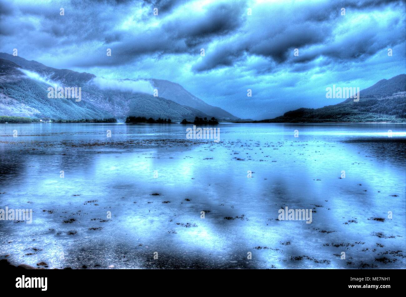 Area of Gen Coe, Scotland. Artistic dusk view of Loch Leven, with North and South Ballachulish in the distant background. - Stock Image