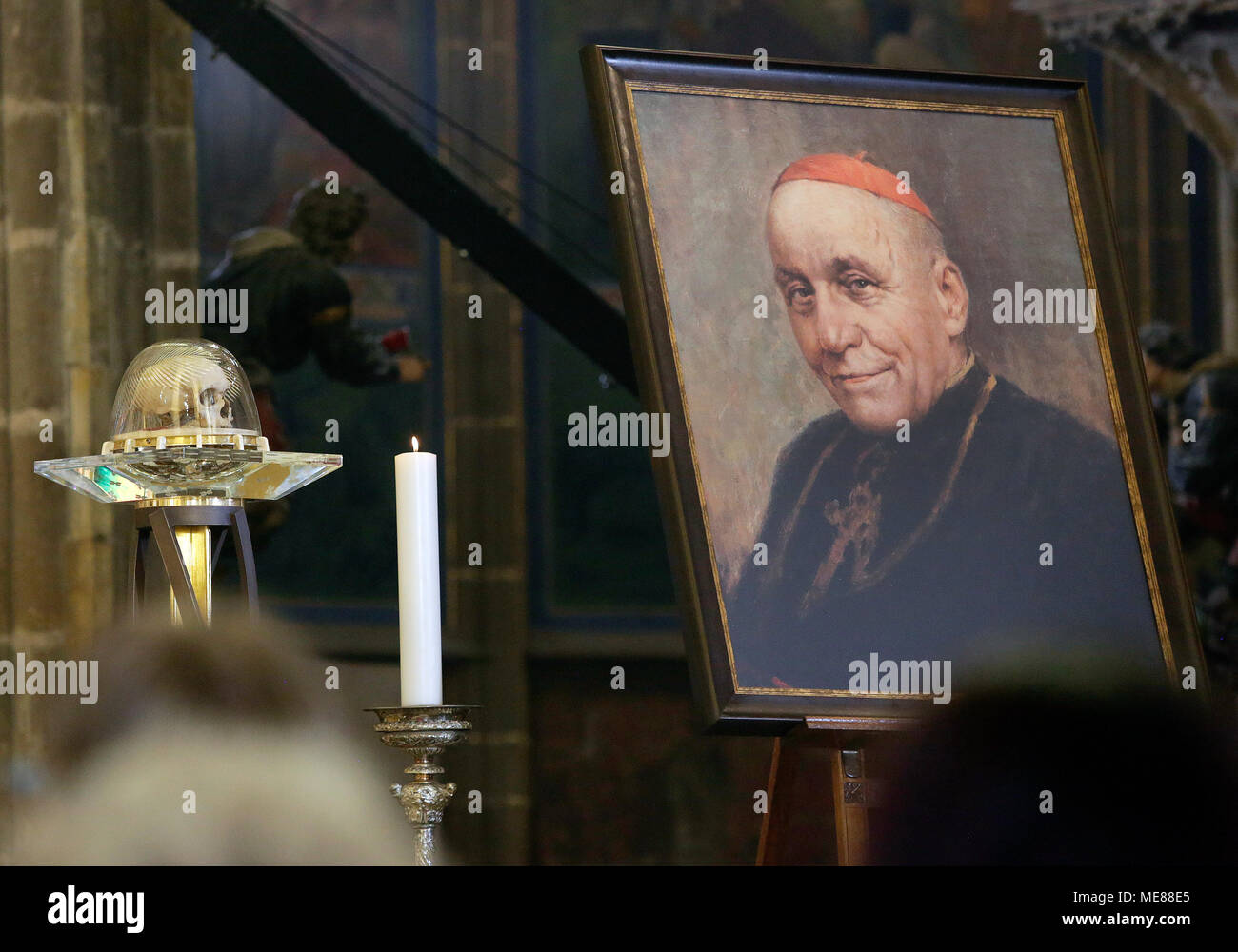 Church dignitaries and hundreds of church-goes paid homage to the memory of Cardinal Josef Beran (1888-1969), who was repatriated from the Vatican after an extended period of exile enforced upon him by the Communist regime, in the Saint Vitus Cathedral in Prague today, on Saturday, April 21, 2018. The mass was served by Prague Archbishop Cardinal Dominik Duka. 'I welcome my glorious predecessor,' Duka said at the opening of the mass. Duka also turned to the current events. He said the moments when Communists despite their electoral defeat were demanding an increasing share of power, were among - Stock Image