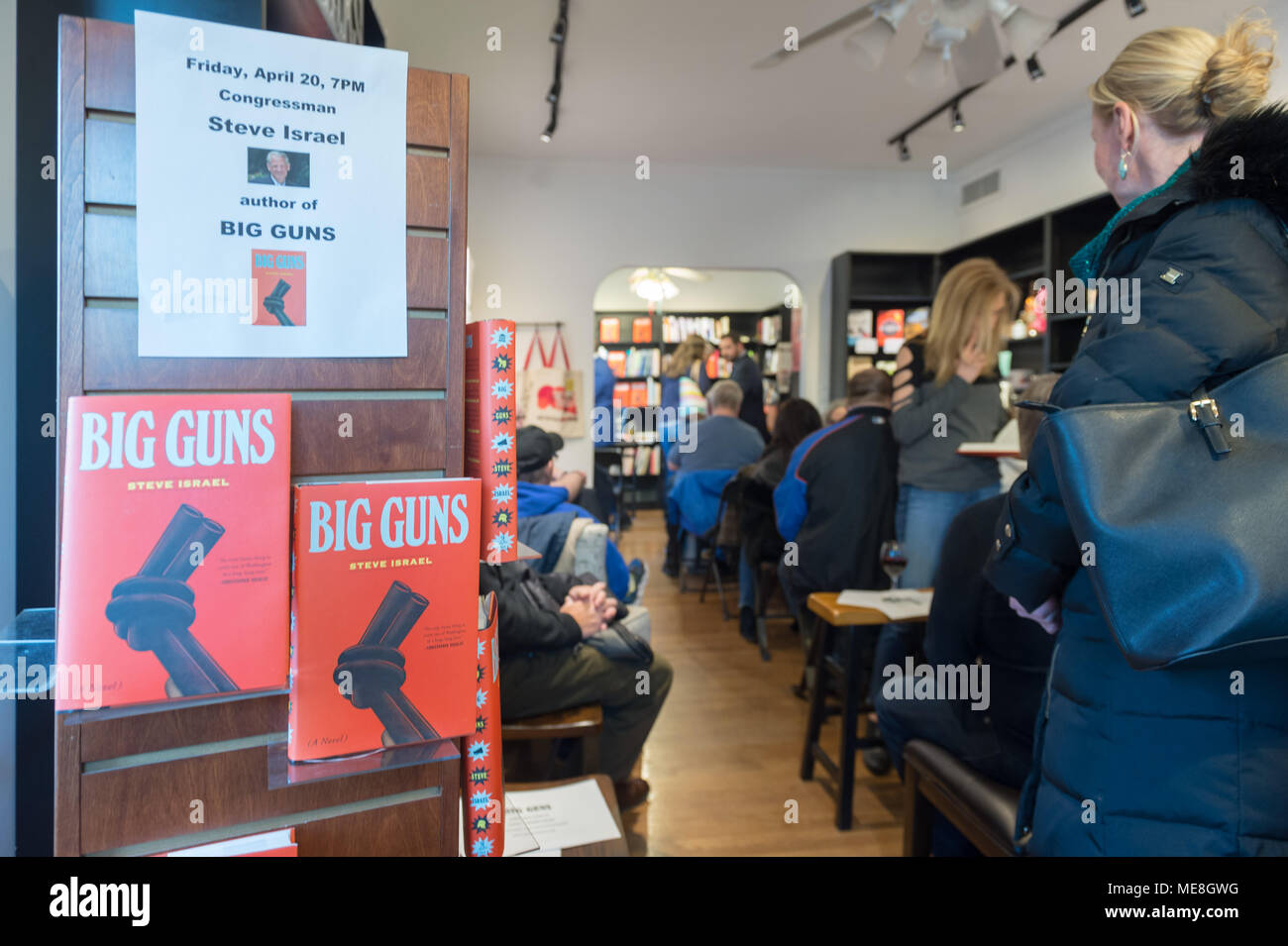 Rockville Centre, New York, USA. 20th Apr, 2018. On display at Turn of the Corkscrew Books & Wine store are copies of Rep. Steve Israel's newest novel BIG GUNS and a flyer with information about the special event about to start there for Nassau County debut of the former Congressman's (NY - Dem) book. BIG GUNS is a satire of the strong gun lobby, weak Congress, and a small Long Island town. Credit: Ann Parry/ZUMA Wire/Alamy Live News - Stock Image