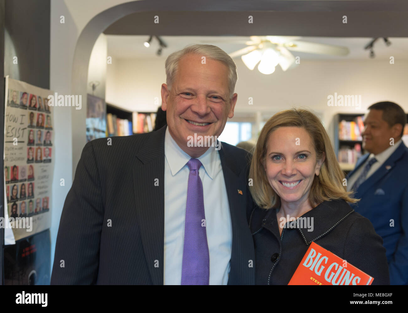 Rockville Centre, New York, USA. 20th Apr, 2018. L-R, Rep. STEVE ISRAEL and Town of Hempstead Supervisor LAURA GILLEN pose for photo at special event for Nassau County debut of the former Congressman's (NY - Dem) newest novel BIG GUNS - a satire of the strong gun lobby, weak Congress, and a small Long Island town. The talk and book signing was held at Turn of the Corkscrew Books & Wine store. Credit: Ann Parry/ZUMA Wire/Alamy Live News - Stock Image