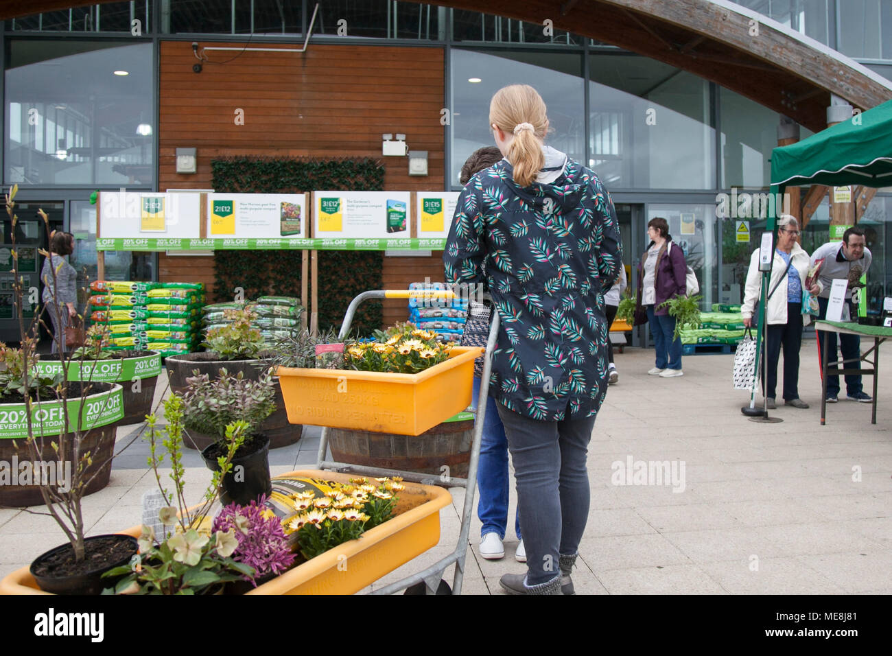Southport, Merseyside, UK 22 April 2018. . UK Weather. Gardeners flock to Garden Centres as the warm weather continues, tempered with light showers earlier in the day. Springtime bonanza for local gardening stores with buyers taking advantage of discounted items.  Credit; MediaWorldImages/AlamyLiveNews.MediaWorldImages/AlamyLiveNews. Stock Photo