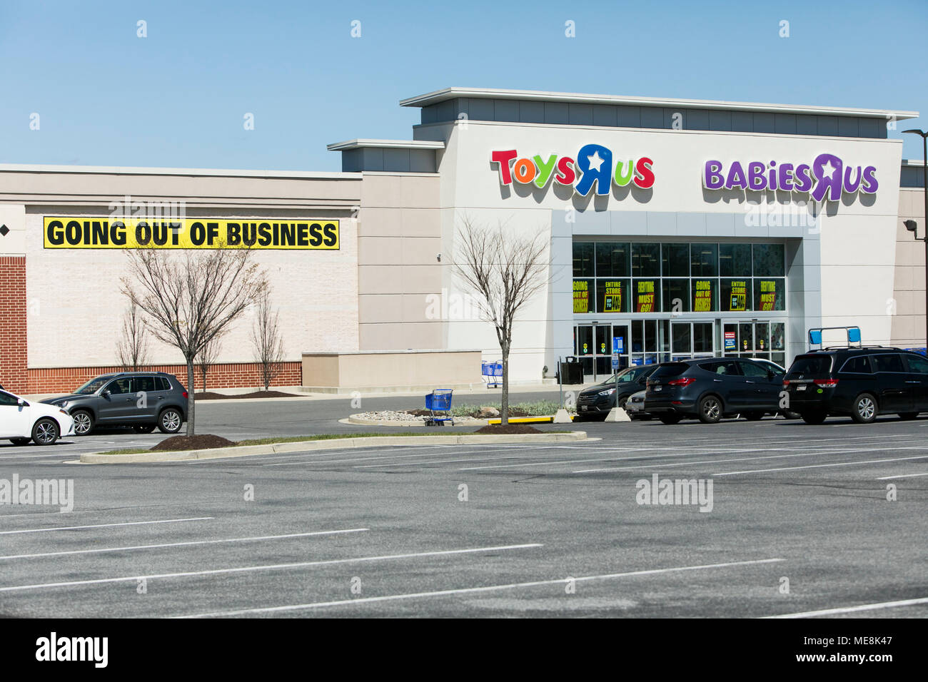 A Logo Sign Outside Of A Joint Toys R Us And Babies R Us Retail