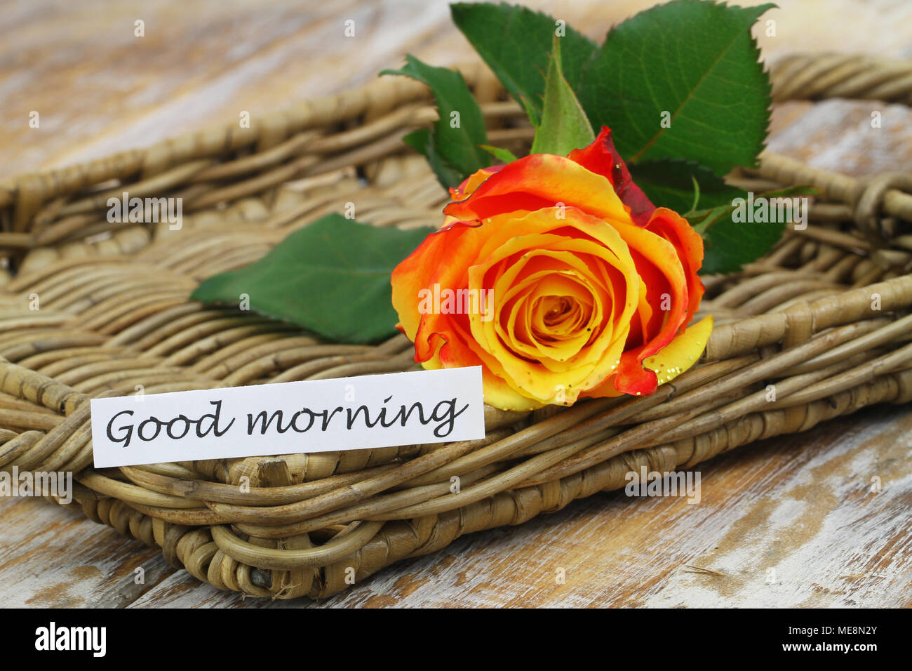 Good Morning Card With One Red And Yellow Rose Sprinkled With Glitter On Wicker Surface Stock Photo Alamy