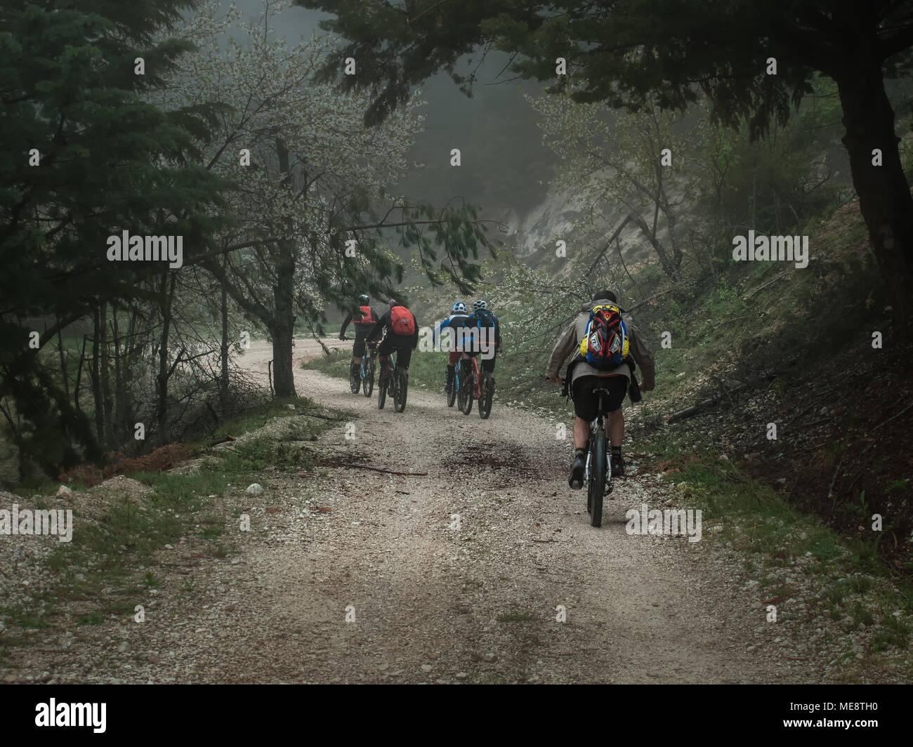 mountin bikers in the haze - Stock Image