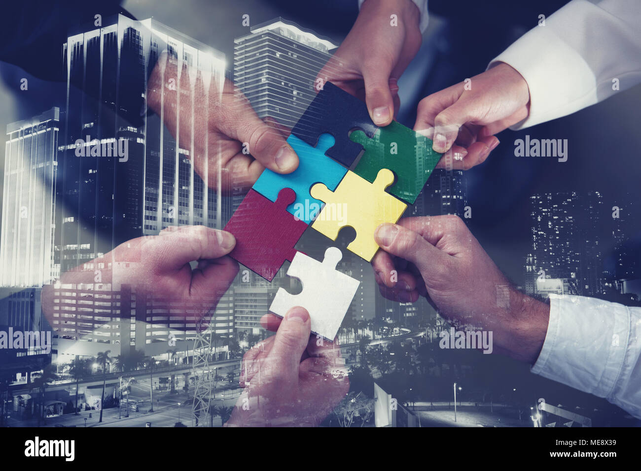 Teamwork of partners. Concept of integration and startup with puzzle pieces. double exposure - Stock Image