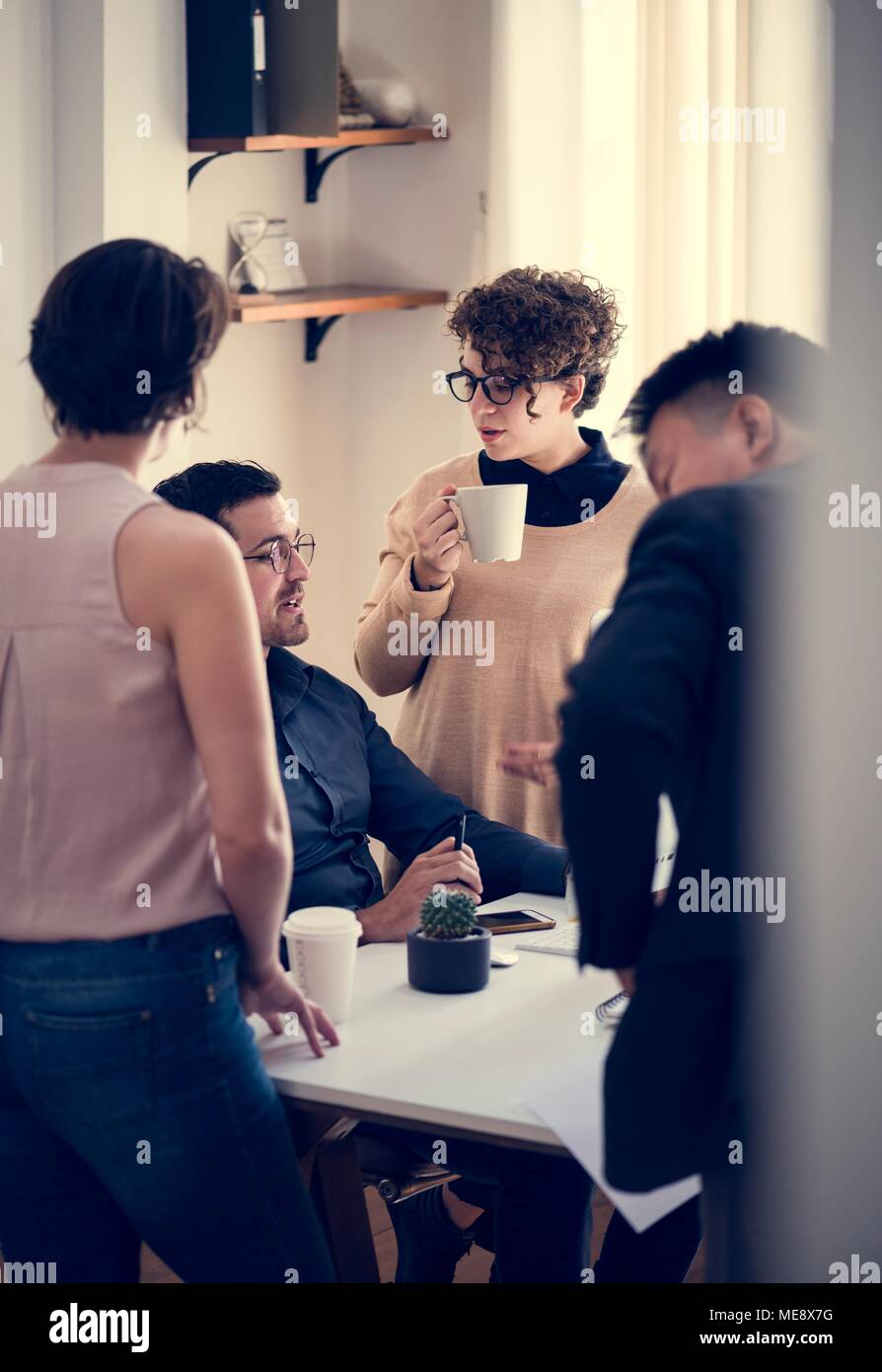 Co-workers working together - Stock Image