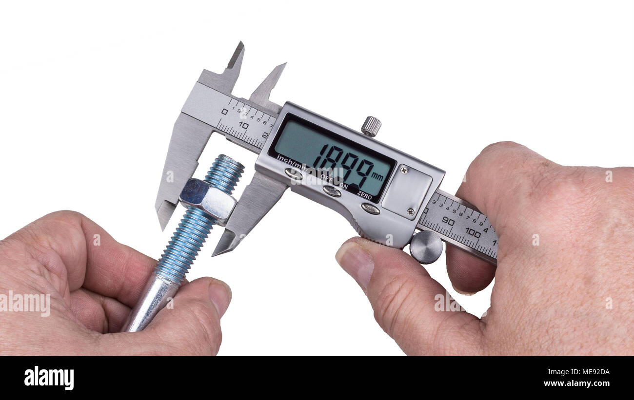 Precise measurement of bolt and nut by digital caliper. Detail of technical expert's hands holding metallic measuring device and threadded steel part. - Stock Image