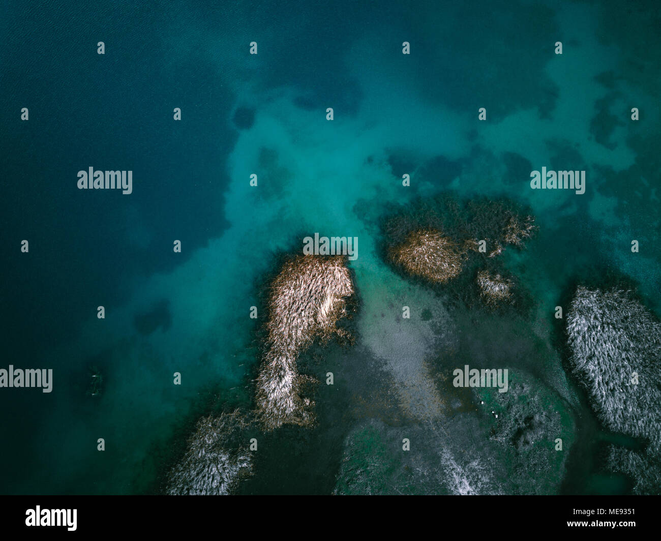 This is a drone shot from lake doxa in Greece. The water had this combination of turquoise and green color and created interesting patterns. - Stock Image