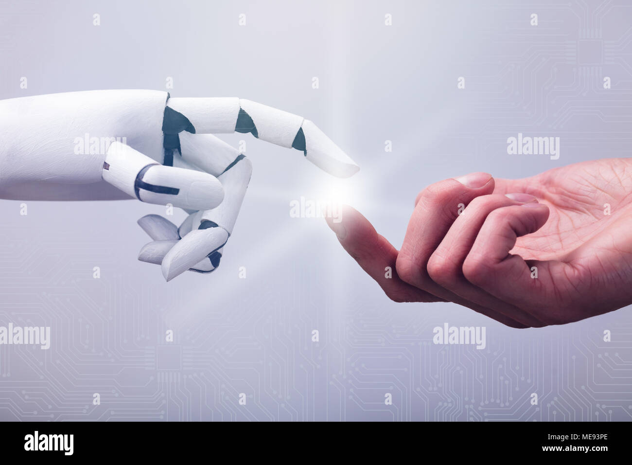 Robot Touching Human Finger Against Technology Background - Stock Image
