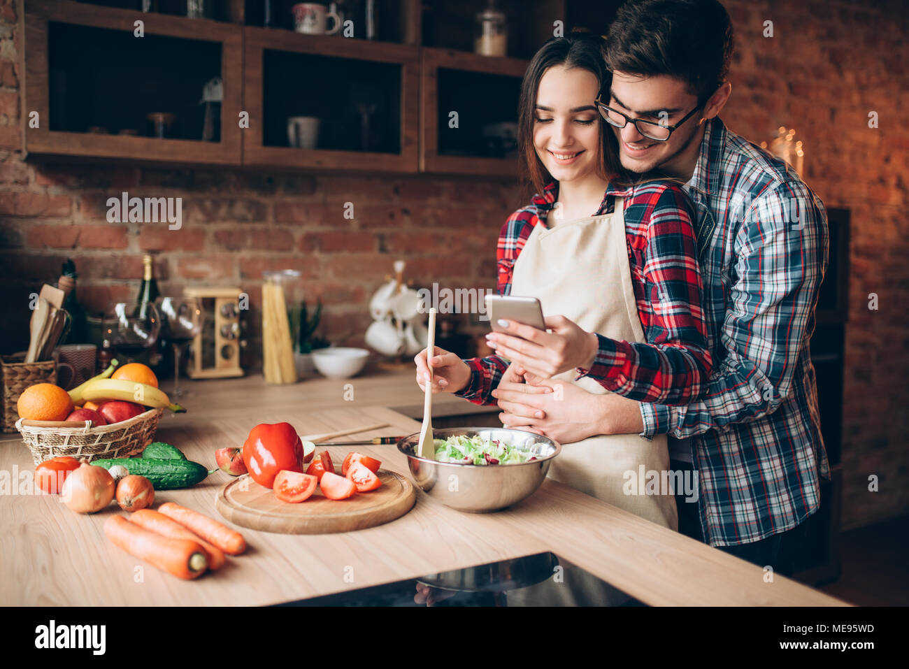 Happy Love Couple Prepares Romantic Dinner On The Kitchen Smiling