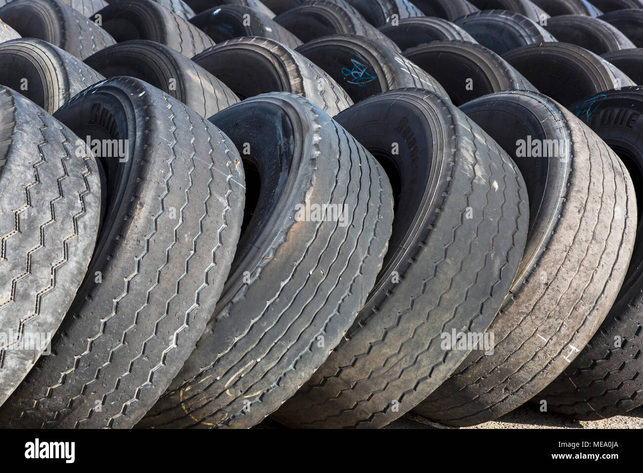 Used lorry tyres, in a dump before disposal, Troon, Ayrshire, Scotland - Stock Image