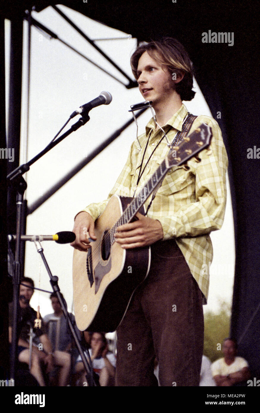 Recording artist Beck, with acoustic guitar, on stage at the Lollapalooza music festival in Tinley Park, Illinois, in 1995. - Stock Image