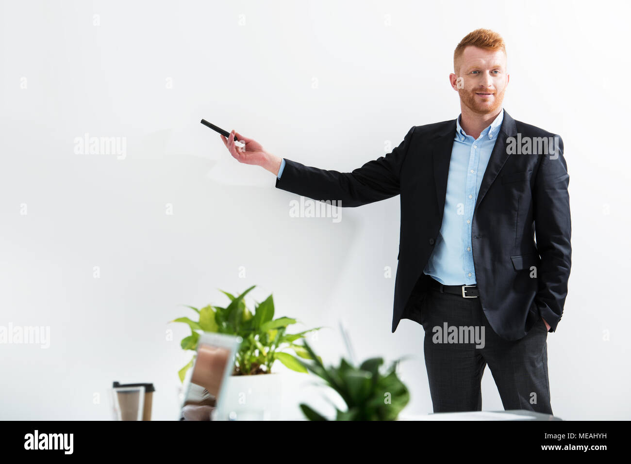 Businessman in office explain something at a training meeting - Stock Image