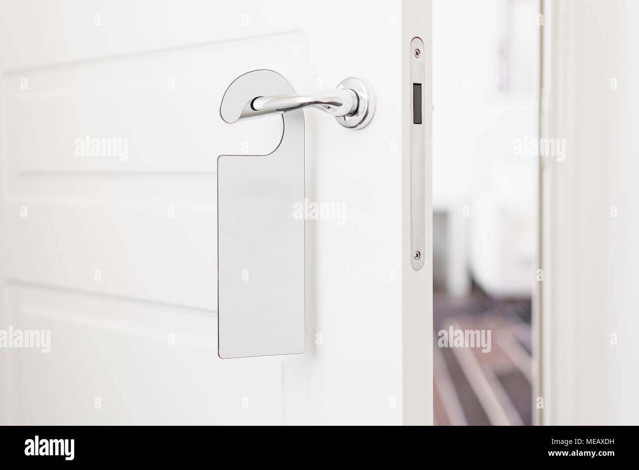 Door Knob With Empty Label On A Door Handle For Your Text. Empty White  Flyer Mockup Hang On Door Handle. Leaflet Design On Entrance Doorknob.