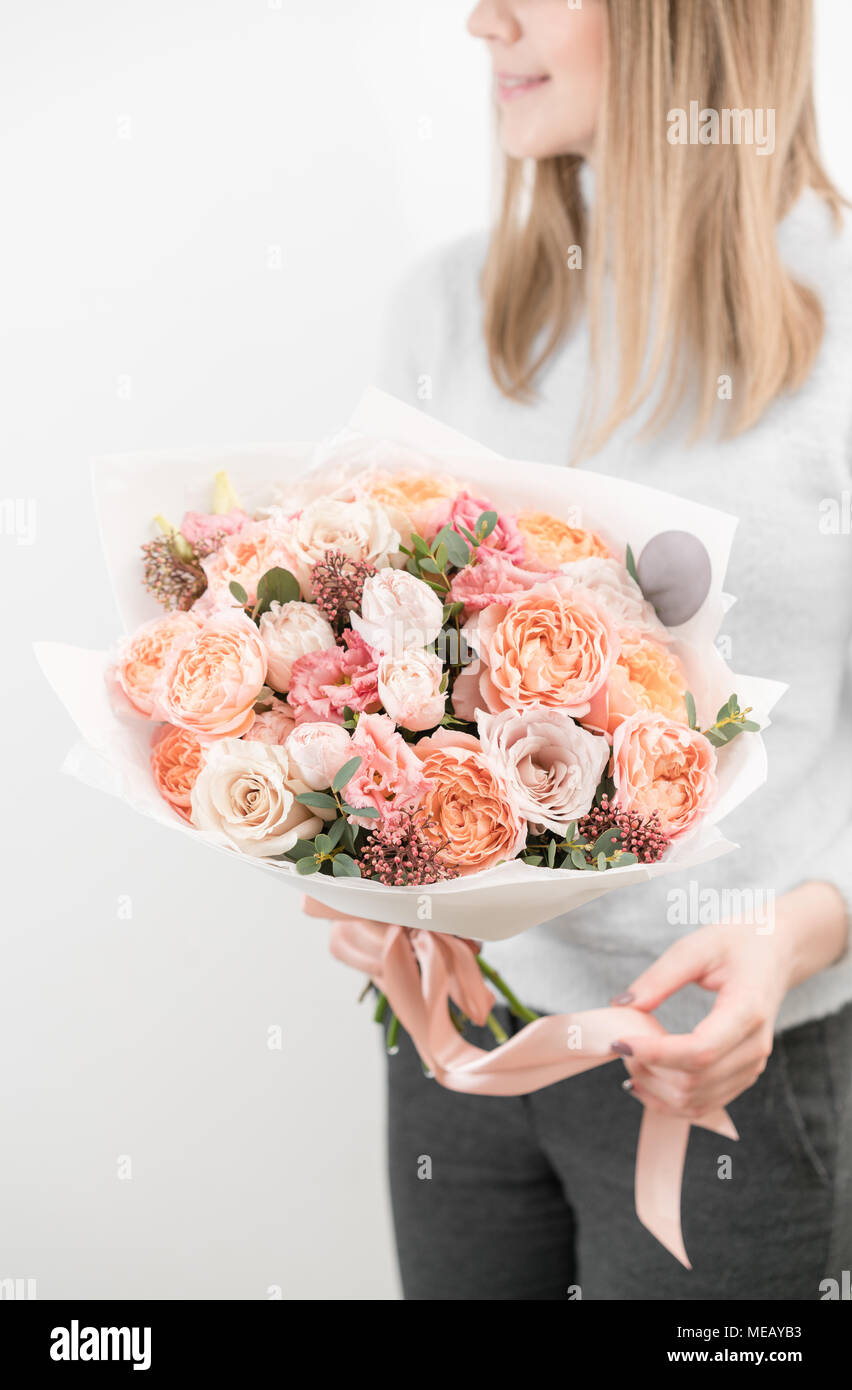 Bouquet of beautiful flowers in womens hands floristry concept bouquet of beautiful flowers in womens hands floristry concept spring colors the work of the florist at a flower shop vertical photo izmirmasajfo