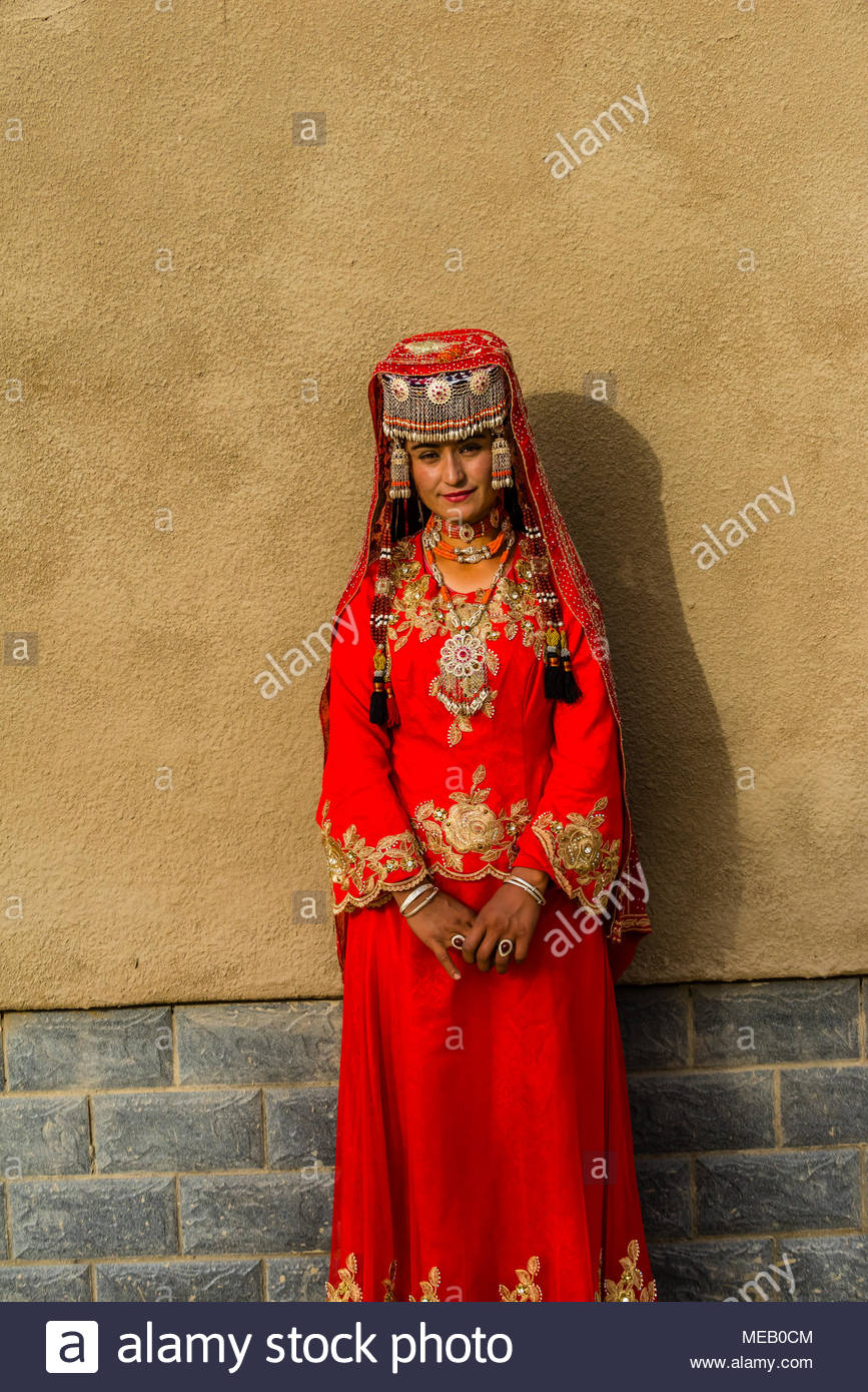 A Tajik minority woman in traditional clothing, Taxkorgan is along the Karakoram Highway (Historically, this was a caravan stop of the ancient Silk Ro - Stock Image