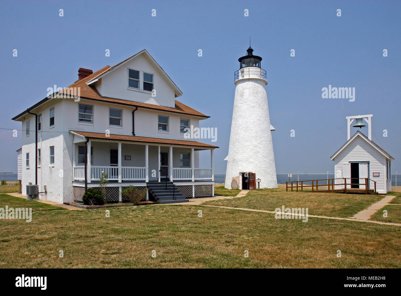 Cove Point Lighthous Station showing tower, fog bell building and keepers duplex. - Stock Image