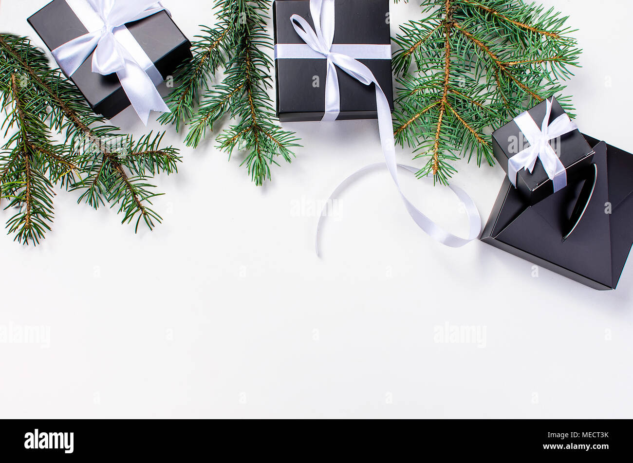 black and white christmas background black gift box balls fir branches silver christmas decorations on the white background copy space - Black And Silver Christmas Decorations