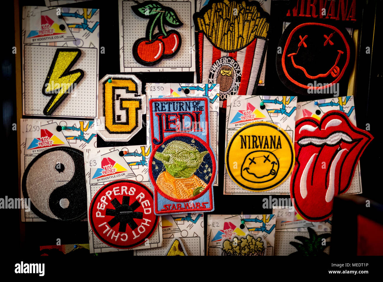Embroidered vintage Metal Rock Punk Indie Music Band Sew Iron On Patches on display in the UK including, Red Hot Chili Peppers, Nirvana, Rolling Stone - Stock Image