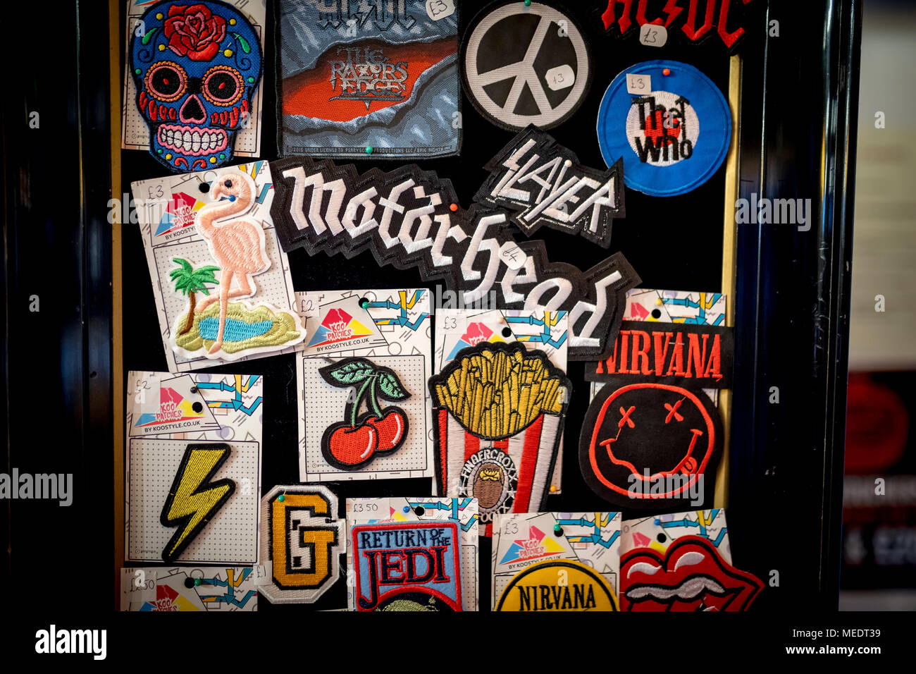 Embroidered vintage Metal Rock Punk Indie Music Band Sew Iron On Patches on display in the UK including Motorhead, ACDC, Nirvana, Rolling Stones and R - Stock Image