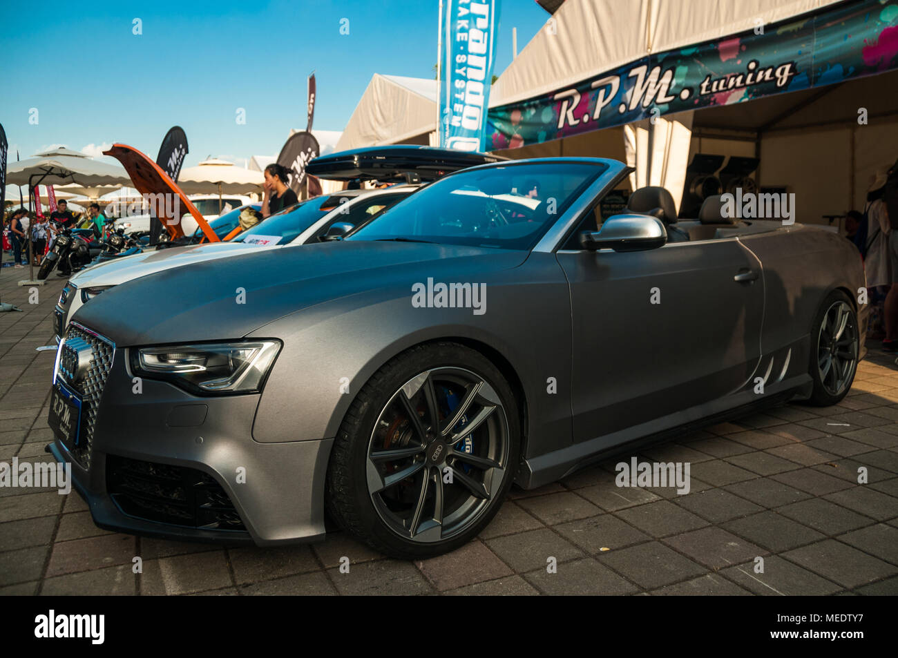 An Audi A5 convertible heads up a line of tuned Audis displayed by RPM Tuning at an Audi Sport event at the Shanghai International Circuit. - Stock Image