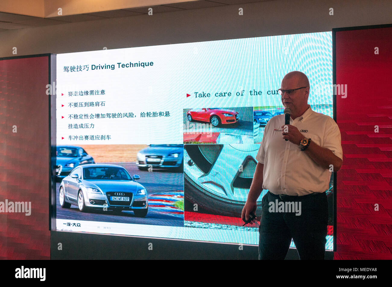 Talk on cornering technique before going on the track at an Audi Driving Experience Day held at the Shanghai International Circuit. - Stock Image
