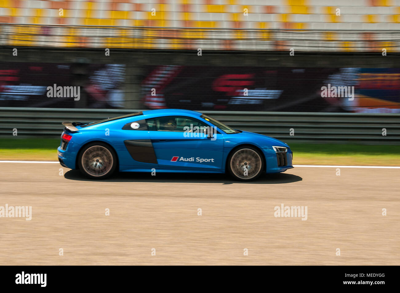 A Blue Audi R8 V10 Coupe Performance Speeds Past The Stands At An Audi  Driving Experience Day Held At The Shanghai International Circuit Stock  Photo: ...