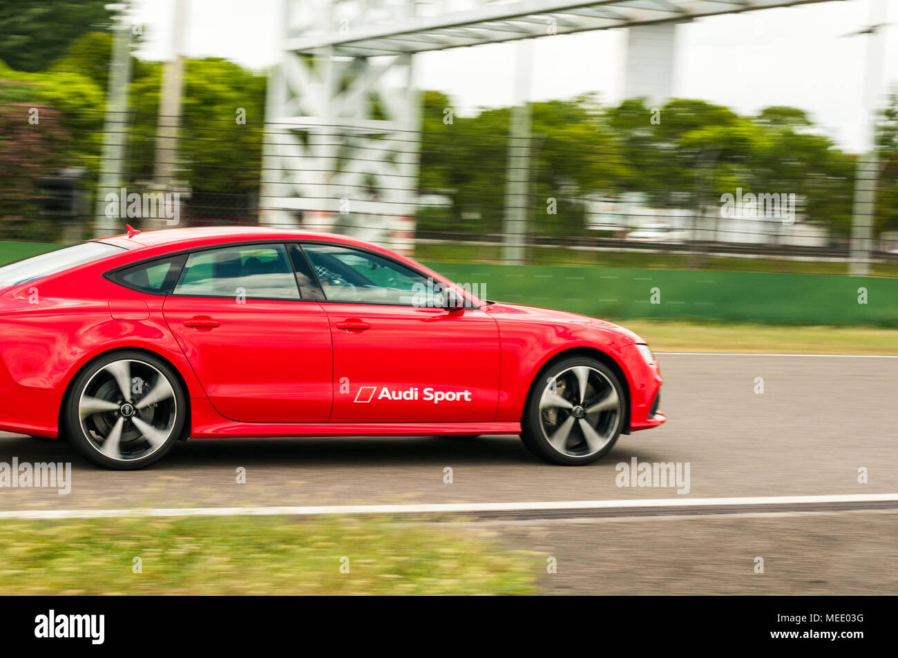 A Red Rs7 Sportback Performance Being Used For Cornering Practice At
