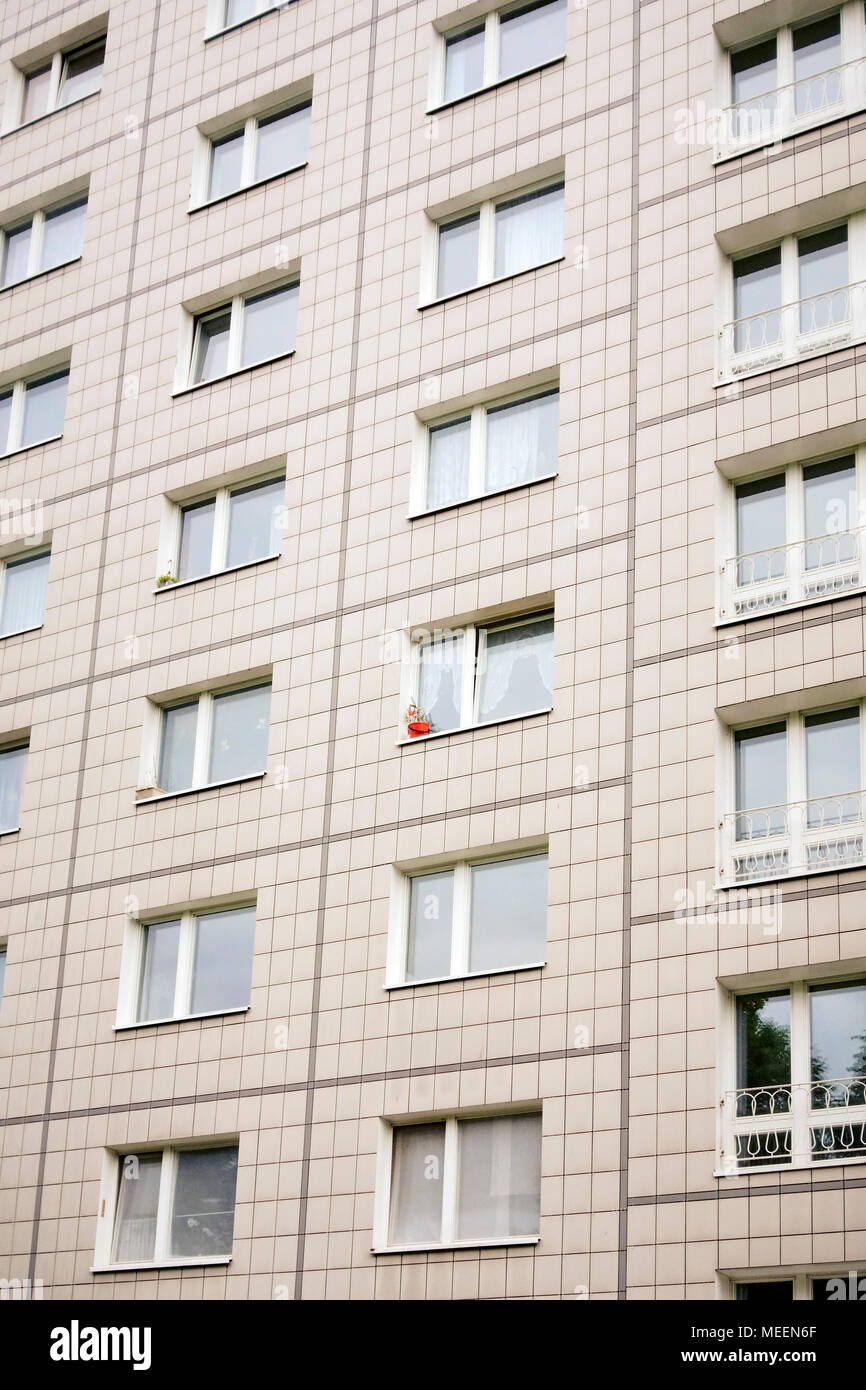 A red plant pot on a Socialist apartment block on the Karl Marx Allee boulevard in Berlin Germany EU. - Stock Image
