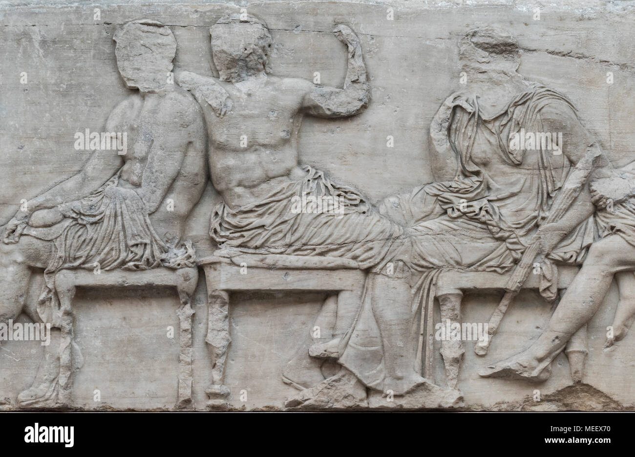 London. England. British Museum, Parthenon Frieze (Elgin Marbles), Olympian gods seated on stools, from the Parthenon on the Acropolis in Athens, ca.  - Stock Image