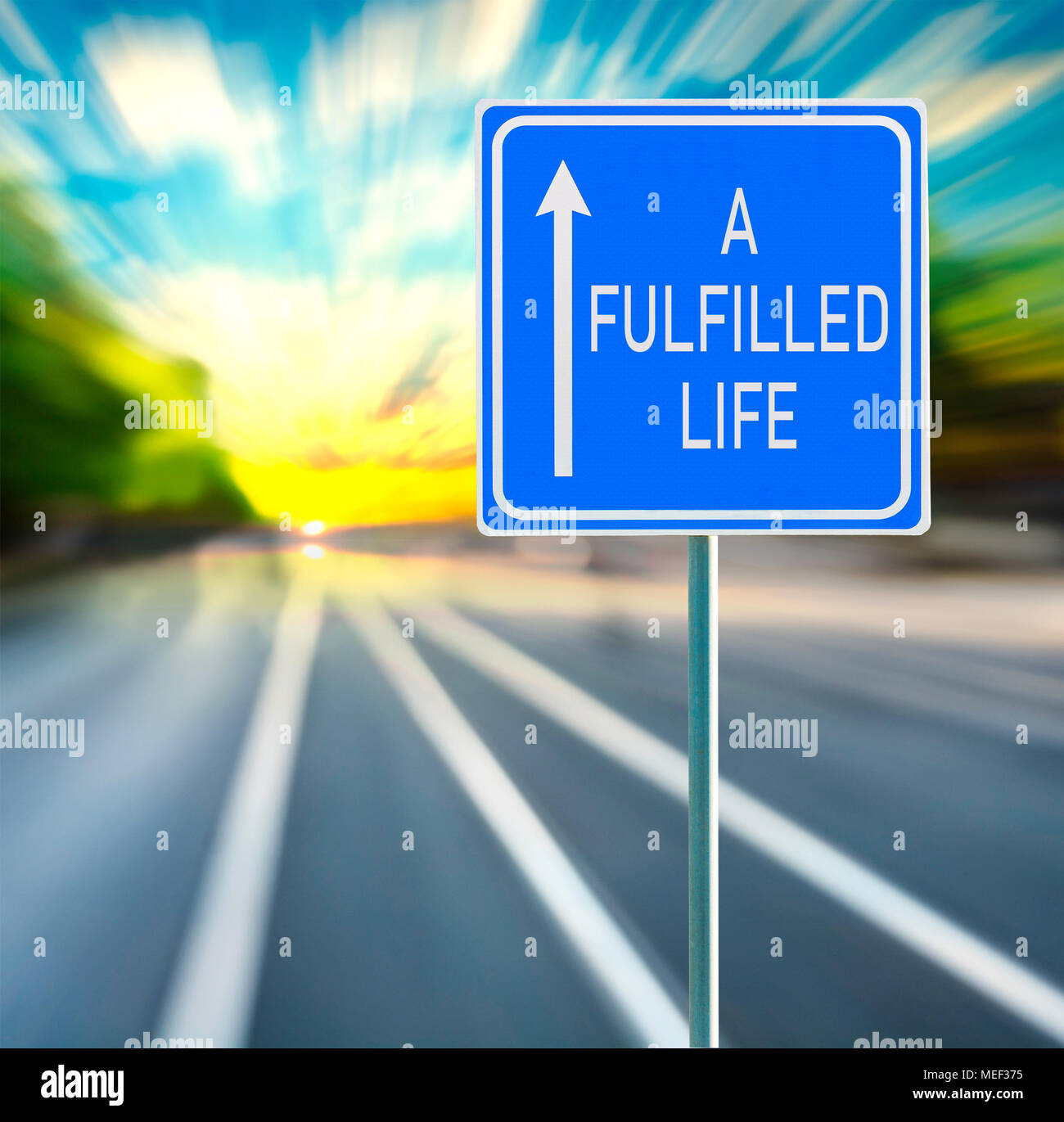 A Fulfilled Life Road Sign on a Speedy Background with Sunset. - Stock Image