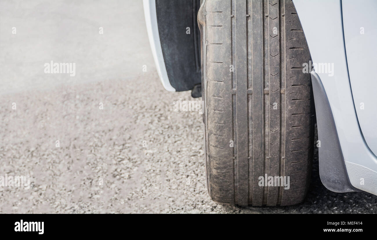 Worn Out and Damaged Car Tire - Stock Image