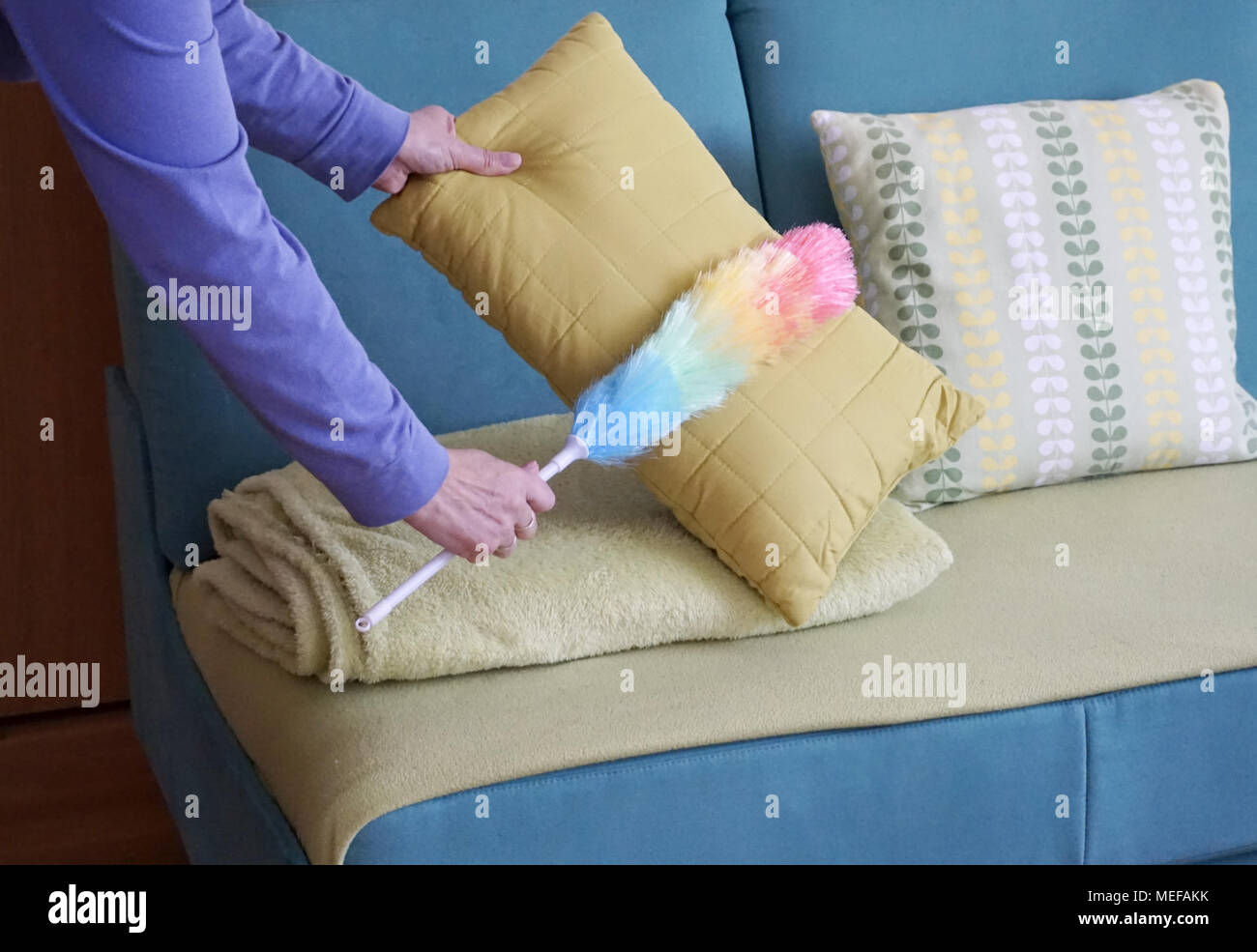 Woman Hands With Dust Cleaner Cleaning Dust In The Living Room, Spring Cleaning  House Concept