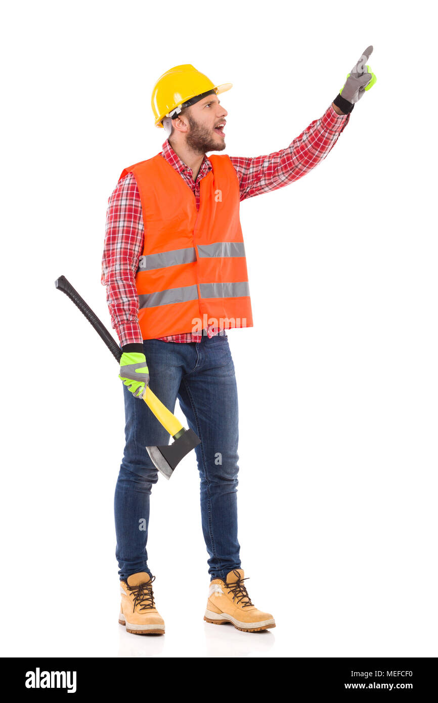 Shouting Man In Reflective Vest And Yellow Helmet Is Holding