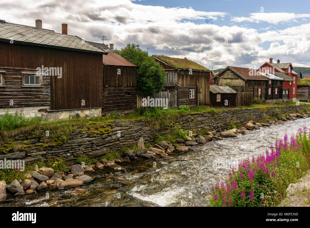 Roros an herritage city in North-Norway Unesco world heritage list houses at river - Stock Image