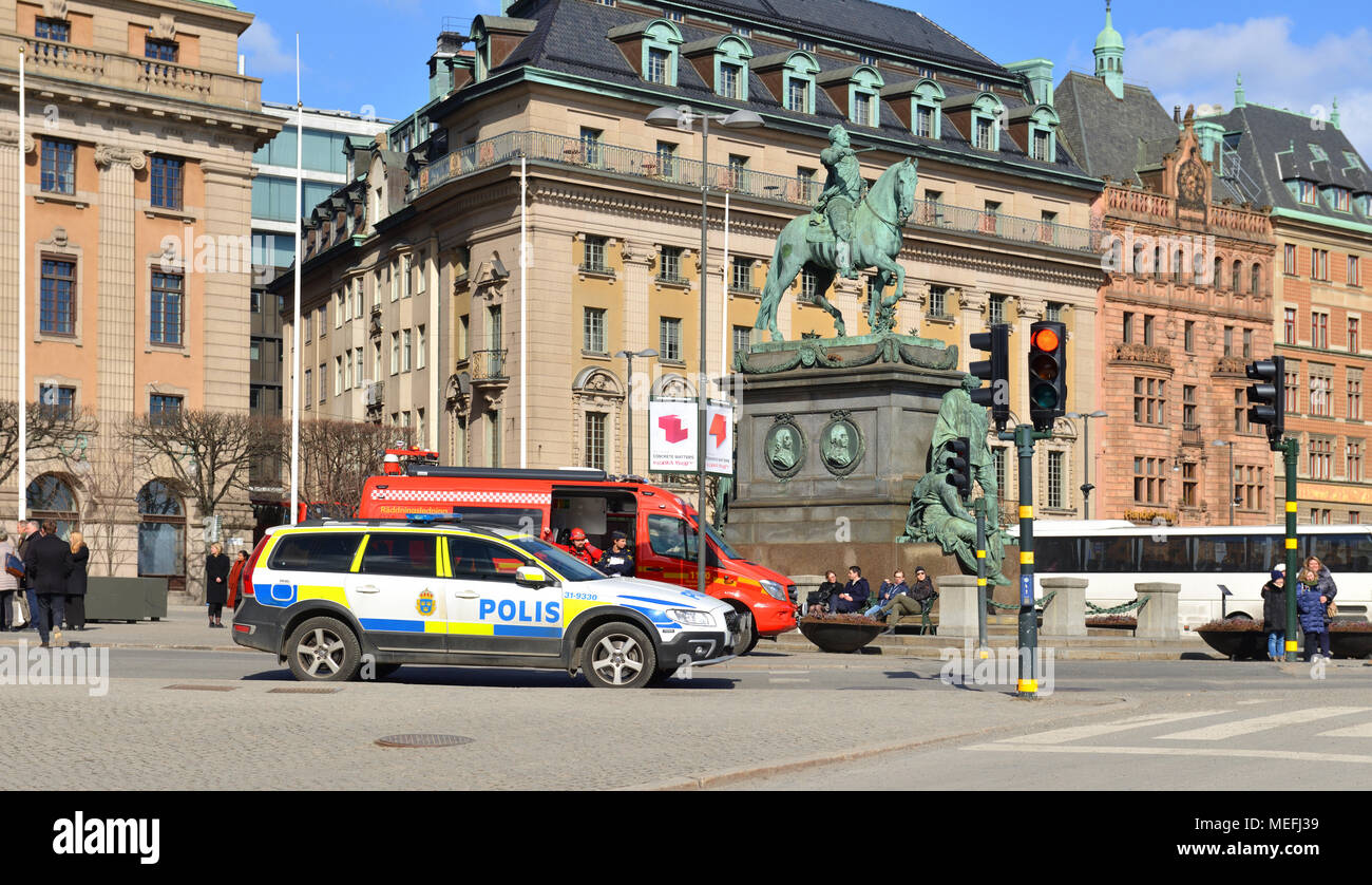 Fire trucks, police and rescue vehicles on Gustav Adolfs torg (square) in spring Stock Photo