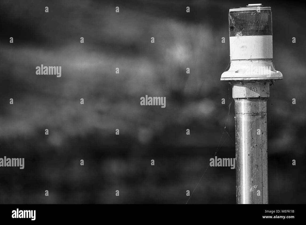 Electric signal lantern on the river water canal, beacon for the boats. - Stock Image