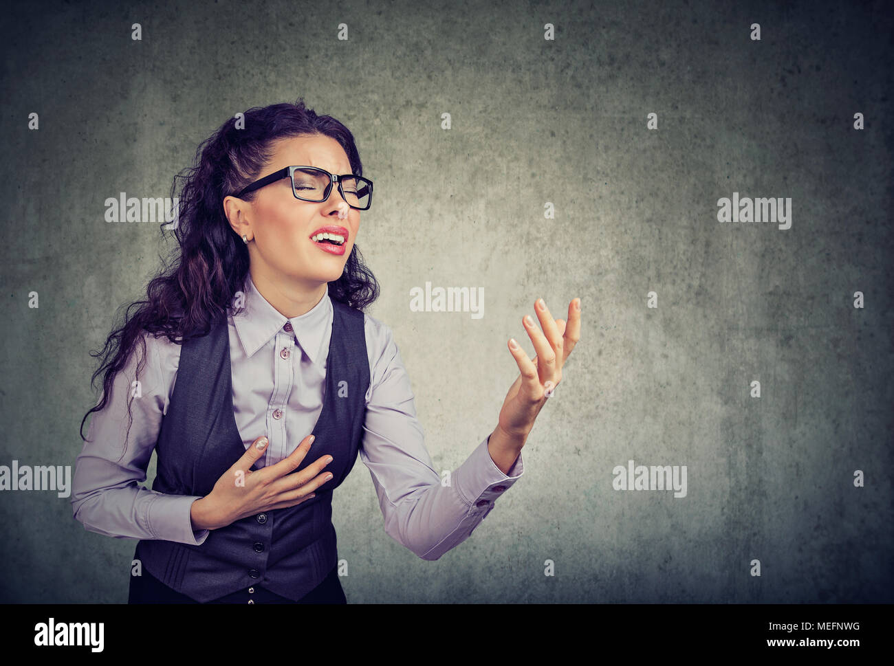 Desperate business woman screaming asking for help forgiveness - Stock Image