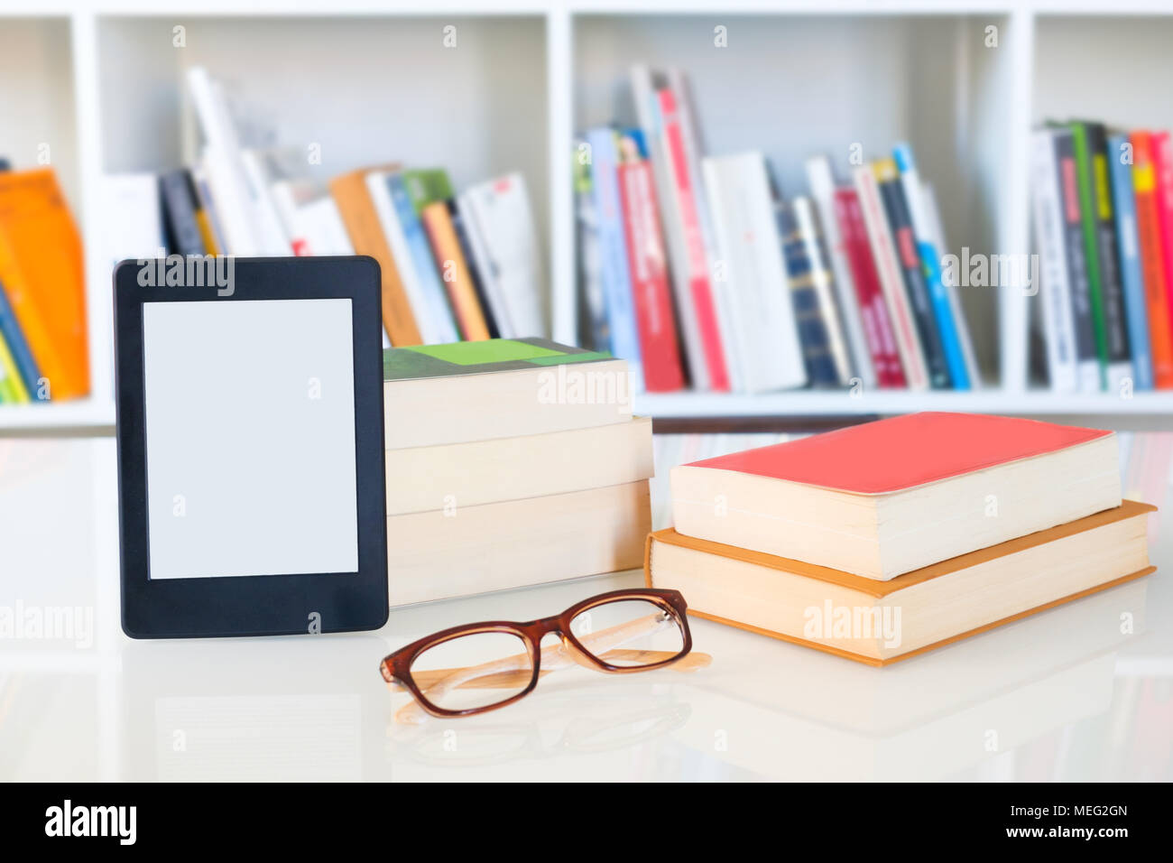 Internet and electronic books concept with e-book reader - Stock Image