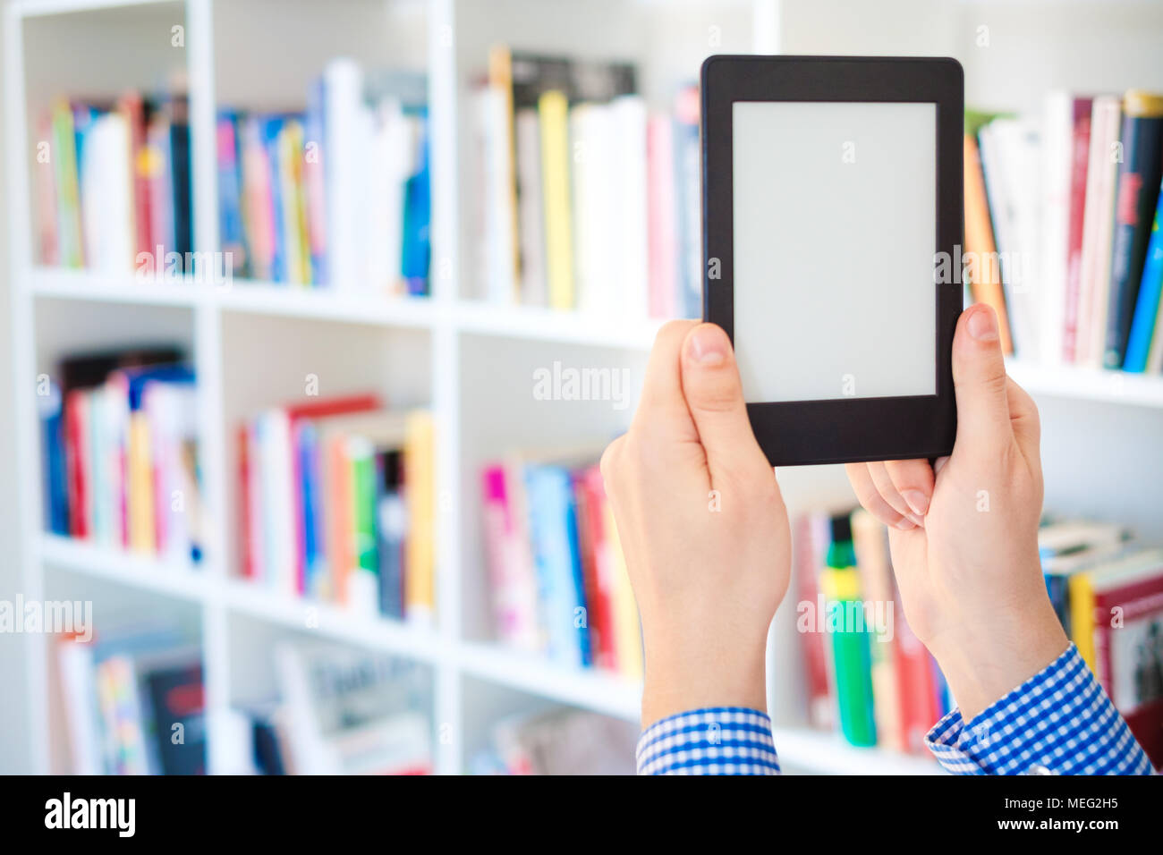 Choosing a buying book and internet book store concept - Stock Image