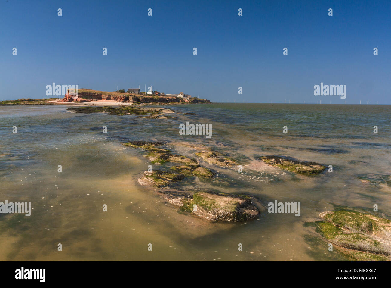 Hilbre Island in the mouth of the River Dee at high tide, Wirral, England - Stock Image